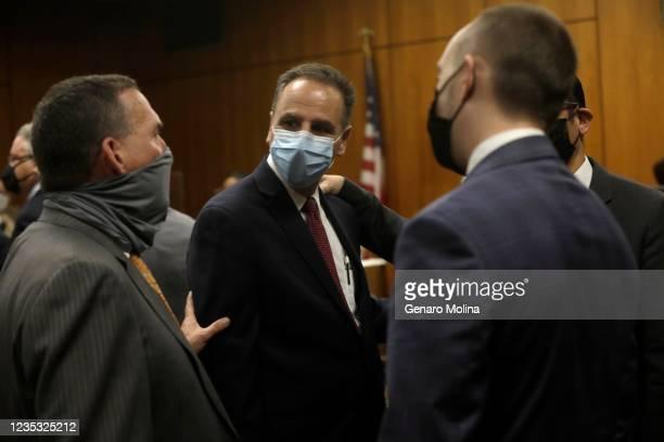 Deputy District Attorney John Lewin, left, congratulates attorney Habib A. Balian, center, after New York real estate heir Robert Durst was found...