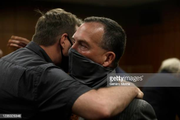 Deputy District Attorney John Lewin, right, is congratulated after New York real estate heir Robert Durst was found guilty of murdering longtime...