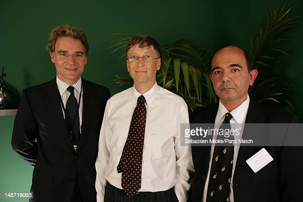 Deputy editor of Paris Match Olivier Royant, businessman Bill Gates and journalist Paul Khayat, photographed at the release of the Xbox 360 in France...