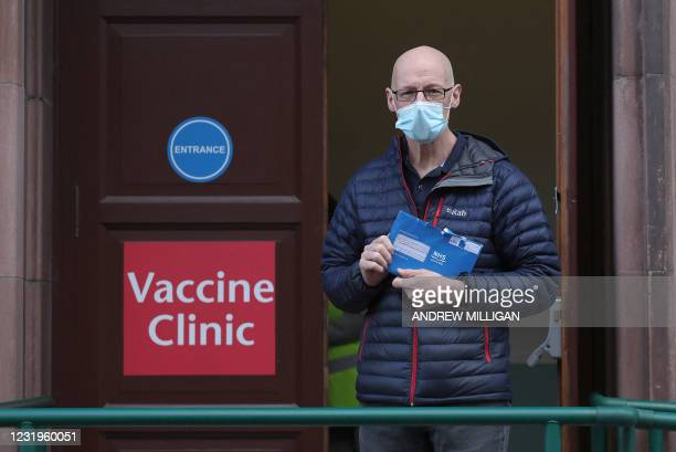 Deputy First Minister John Swinney arrives at the Vaccine Clinic holding his blue envelope which contains his vaccine appointment details ahead of...