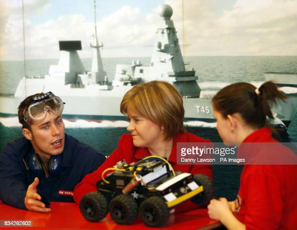 Deputy First Minister Nicola Sturgeon actor Will Roberts and student Jennifer Fraser look at a fake UAV during the launch of the Scottish leg of the...