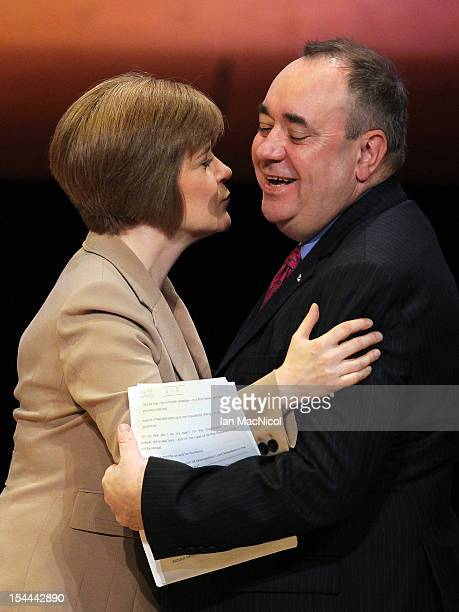 Deputy First Minister Nicola Sturgeon greets The Scottish First Minister Alex Salmond as he speaks at The SNP Annual Conference on October 20 2012 in...