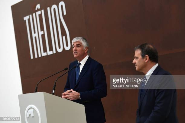 Deputy General Director of the LVMH group Antonio Belloni flanked by CEO of Thelios industry Giovanni Zoppas delivers a speech during the...
