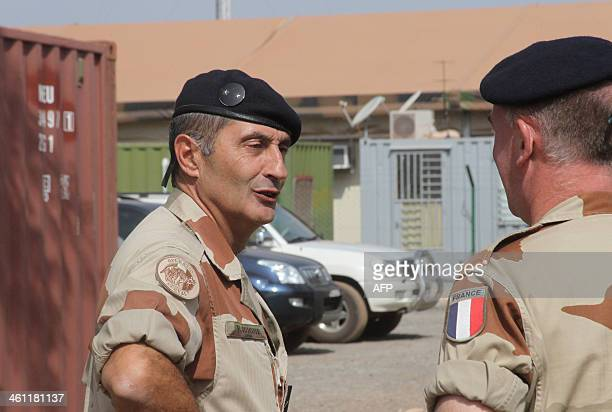 Deputy general of the Serval operation Vincent Guionie speaks with an unidentified officer on January 7 at the Damien Boiteux camp the French army...