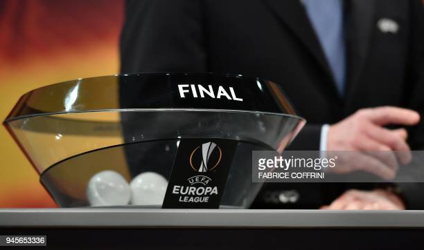 Deputy General Secretary Giorgio Marchetti Giorgio Marchetti gestures ahead of the draw for the semi-finals round of the UEFA Europa League football...