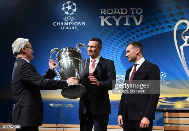 Deputy General Secretary Giorgio Marchetti Giorgio Marchetti hands the trophy to Mayor of Kiev and former boxing champion Vitali Klitschko as former...