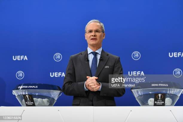 Deputy General Secretary Giorgio Marchetti on stage during the UEFA Europa League 2019/20 Quarterfinal Semifinal and Final draw at the UEFA...