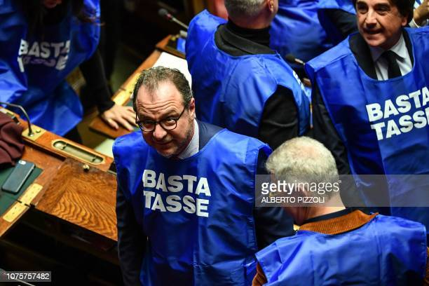 Deputy Giorgio Mule and other deputies from the centreright party Forza Italia wearing blue vests reading Enough taxes and Hands off non profit...