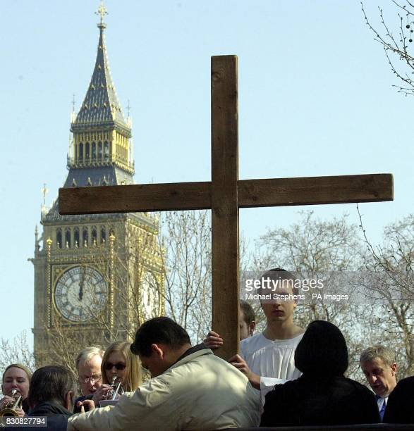 Deputy head prefect of Cardinal Vaughan Memorial School Ben Goddard carries a large cross during the Crucifixtion on Victoria Street ceremony in...