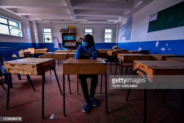 Deputy Headmistress, Rachel Esther, for Kibera School for Girls that is run by Kenya-based charity Shining Hope for Communities sits in an empty...