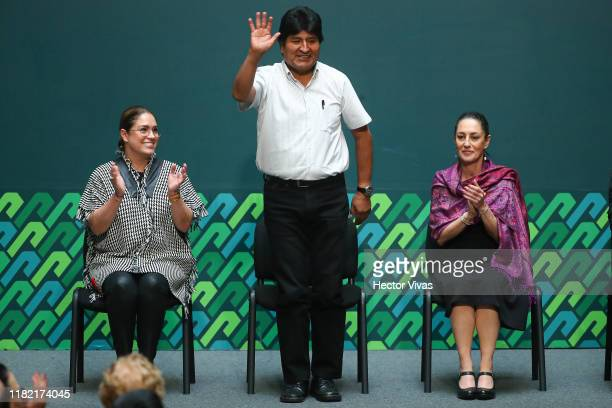 Deputy Isabela Rosales former president of Bolivia Evo Morales and Mayor of Mexico City Claudia Sheinbaum gesture during an event to distinguish Evo...