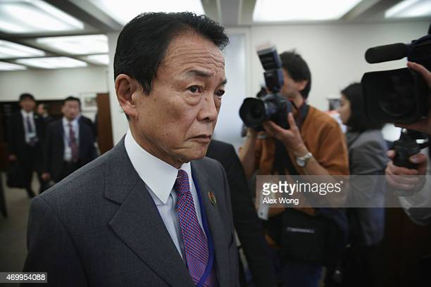 Deputy Japanese Prime Minister and Minister of Finance Taro Aso arrives prior to a meeting with U.S. Secretary of the Treasury Jack Lew at the IMF...