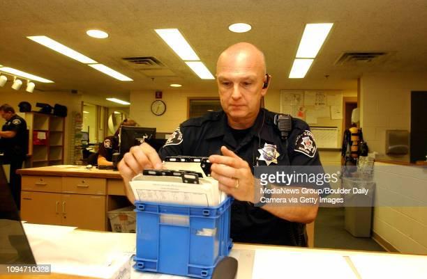 Deputy Kerry Fournet of the Boulder County Sheriff's Department works in the booking room of the Boulder County Jail that will be used to incarcerate...