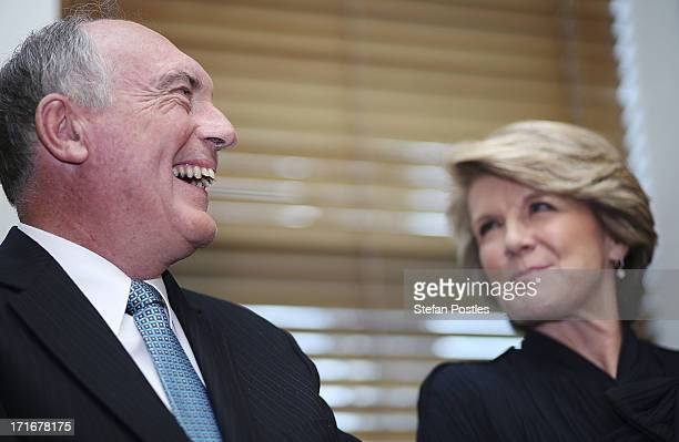 Deputy Leader Julie Bishop and Nationals Leader Warren Truss listen to Opposition Leader Tony Abbott speak to Coalition MPs in the party room on June...