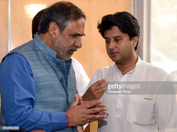 Deputy Leader of Opposition Rajya Sabha Anand Sharma talking with Senior Spokesperson and Lok Sabha MP Jyotiraditya Scindia before addressing a press...
