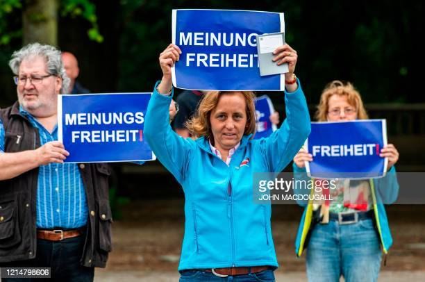 Deputy Leader of the Alternative for Germany Beatrix von Storch holds up a placard reading Freedom of Speech during a protest against lockdown...