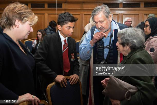 Deputy leader of the Labour party Emily Thornberry a local school boy and Cedric Isaac listen to Holocaust survivor Hana Kleiner on 27th January 2020...