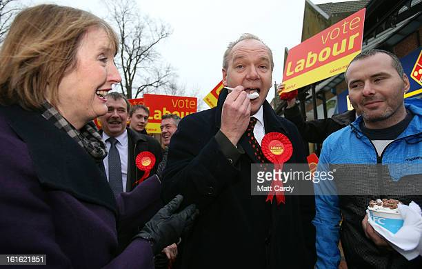 Deputy Leader of The Labour Party Harriet Harman watches as Labour's candidate for the Eastleigh byelection John O'Farrell tries some ice cream...