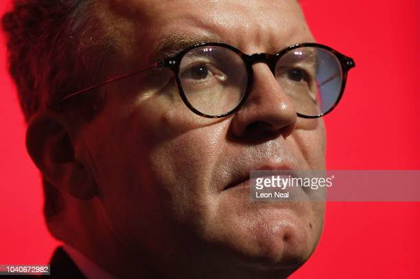 Deputy Leader of the Labour Party Tom Watson listens as Labour Party leader Jeremy Corbyn addresses delegates on day four of the Labour Party...