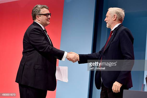 Deputy Leader of the Labour party Tom Watson takes applause with Labour Leader Jeremy Corbyn following his closing speech on the final day of the...