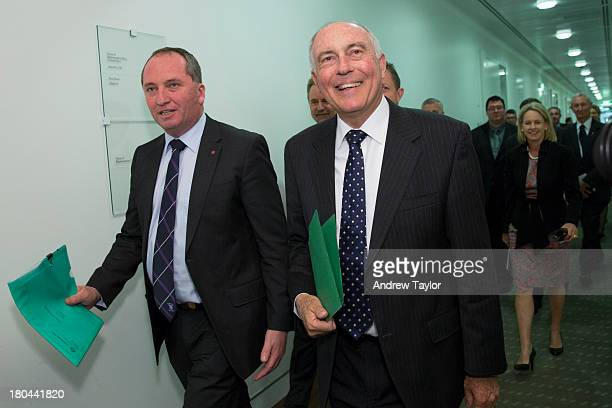 Deputy leader of the Nationals Barnaby Joyce with leader Warren Truss walk from their party meeting to the coalition's joint party meeting on...