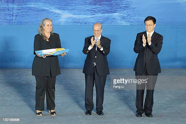 Deputy Mayor of Barcelona Maite Fandos receives the FINA flag from FINA President Julio Maglione and Shanghai Mayor Han Zheng during the closing...
