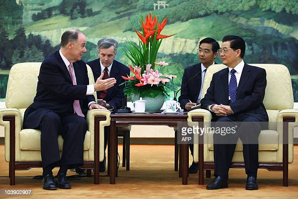 Deputy National Security Adviser Thomas Donilon speaks to Chinese President Hu Jintao during their meeting at the Great Hall of the People in Beijing...