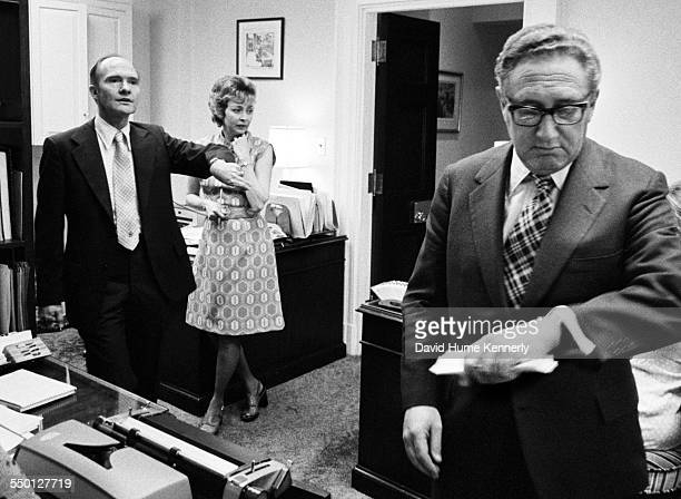 Deputy National Security Advisor Brent Scowcroft and Secretary of State Henry Kissinger discuss when 11 Marines who were stranded on the roof of the...
