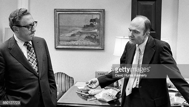 Deputy National Security Advisor Brent Scowcroft tries to explain to his boss Secretary of State Henry Kissinger why 11 Marines were stranded on the...