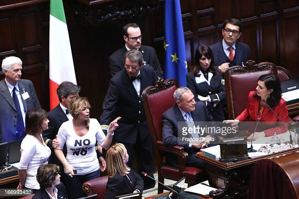 Deputy of Popolo della Liberta' party Alessandra Mussolini protests with President of Chamber of Deputies Laura Boldrini as Parliament votes for...