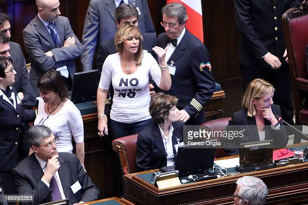 Deputy of Popolo della Liberta' party Alessandra Mussolini wears a tshirt with writing meaning 'No This No' as Parliament votes for President of...