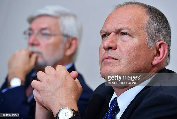 Deputy Plan Commissioner Jan Verschooten with Plan Commissioner Henri Bogaert look on during a press conference by the Central Economic Council /...