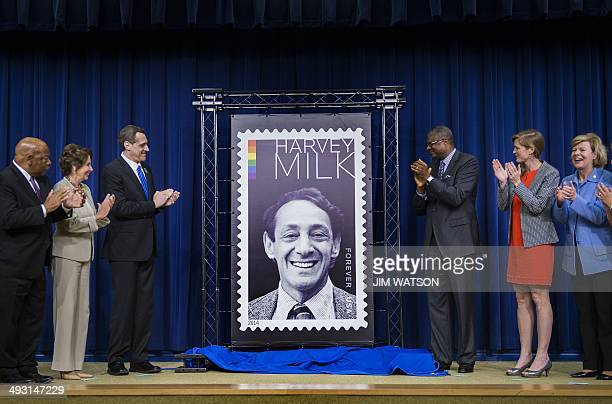 Deputy Postmaster General Ronald Stroman and Cofounder and President of the Harvey Milk Foundation Stuart Milk unveil the Harvey Milk Forever stamp...