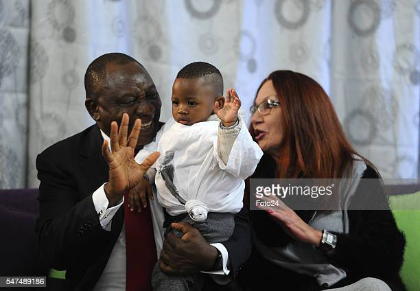 Deputy President Cyril Ramaphosa and HIV Aids activist Gail Johnson play with a oneyearold boy during Ramaphosas visit at Nkosis Haven on July 13...