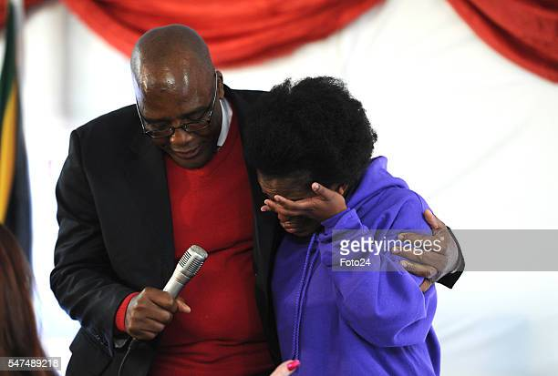 Deputy President Cyril Ramaphosa comforts Mpho Bagaqane during his visit at Nkosis Haven on July 13 2016 in Johannesburg South Africa Ramaphosa...