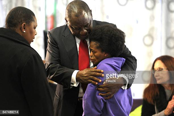 Deputy President Cyril Ramaphosa hugs Mpho Bagaqane during his visit at Nkosis Haven on July 13 2016 in Johannesburg South Africa Ramaphosa honoured...