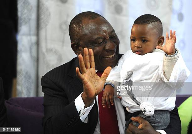 Deputy President Cyril Ramaphosa plays with a oneyearold boy during his visit at Nkosis Haven on July 13 2016 in Johannesburg South Africa Ramaphosa...
