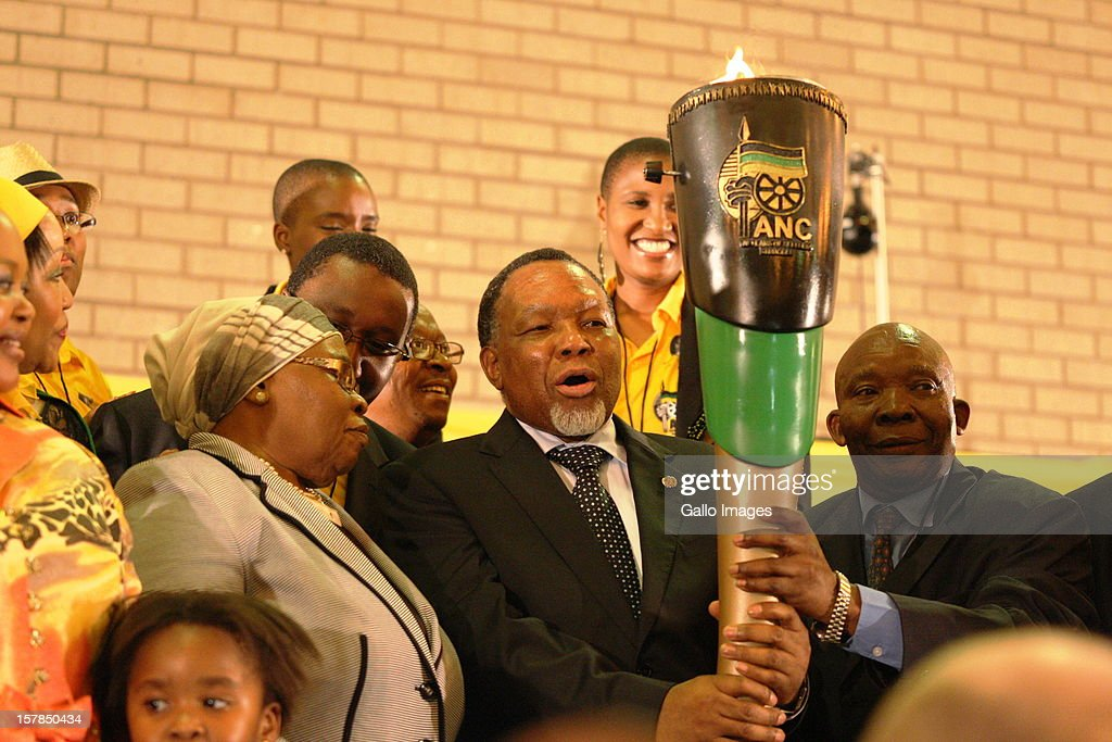 Deputy President Kgalema Motlanthe hands over the centenary flame to the Zuma family at the Jacob Zuma Centennial lecture on December 6, 2012 in Potchefstroom, South Africa. The lecture is part of the ANC's centenary celebrations honouring the party's presidents, and is the last before their elective conference in Mangaung.
