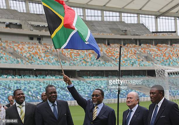 Deputy President Kgalema Motlanthe waves the South African flag at the Moses Mabhida stadium 100 days ahead of the FIFA 2010 World Cup on March 2...