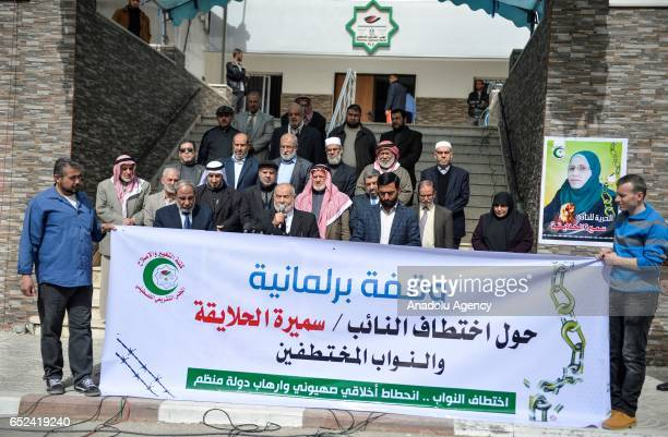Deputy President of Palestinian Parliament Ahmed Bahr speaks during a group of Palestinian MPs' protest demanding the release of Palestinian...