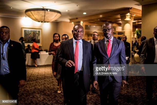 Deputy President of South Africa and newly elected African National Congress President Cyril Ramaphosa and Minister of Finance Malusi Gigaba flanked...