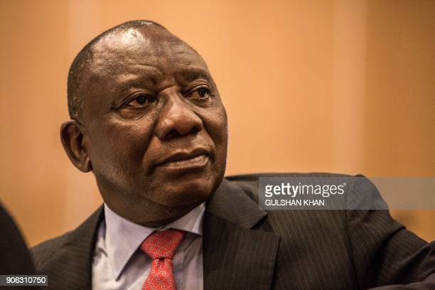 Deputy President of South Africa and newly elected African National Congress President Cyril Ramaphosa looks on during the PreWorld Economic Forum...