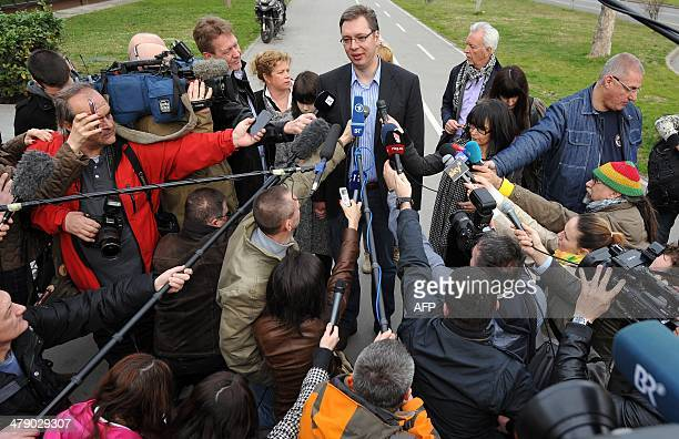 Deputy Prime Minister Aleksandar Vucic and leader of the ruling Serbian Progressive Party addresses the media after casting his ballot in front of a...