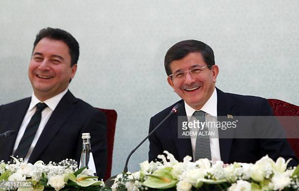 Deputy Prime Minister Ali Babacan and Turkish Prime Minister Ahmet Davutoglu take part in a joint during a press briefing in Ankara on January 8 2015...