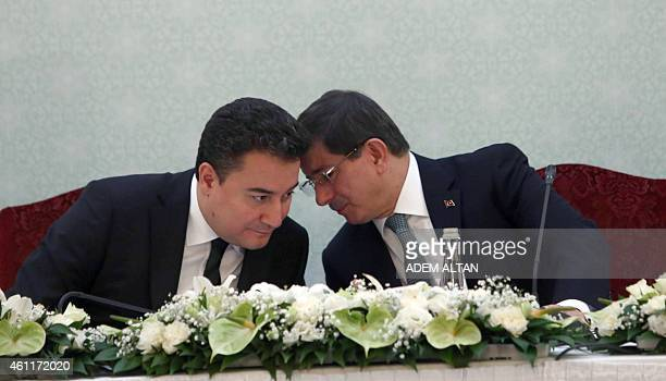 Deputy Prime Minister Ali Babacan and Turkish Prime Minister Ahmet Davutoglu confer during a joint during a press briefing in Ankara on January 8,...