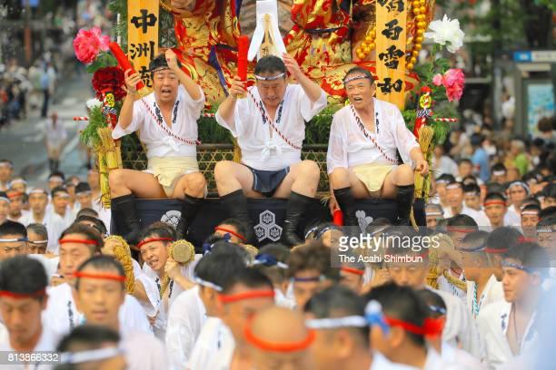 Deputy Prime Minister and Finance Minister Taro Aso and Fukuoka City Mayor Soichiro Takashima are seen on a Hikiyama float during the 'Shudan...
