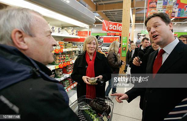 Deputy Prime Minister and Leader of the Liberal Democrat Party Nick Clegg talks to shoppers while visiting ASDA supermarket on January 5 2011 in...