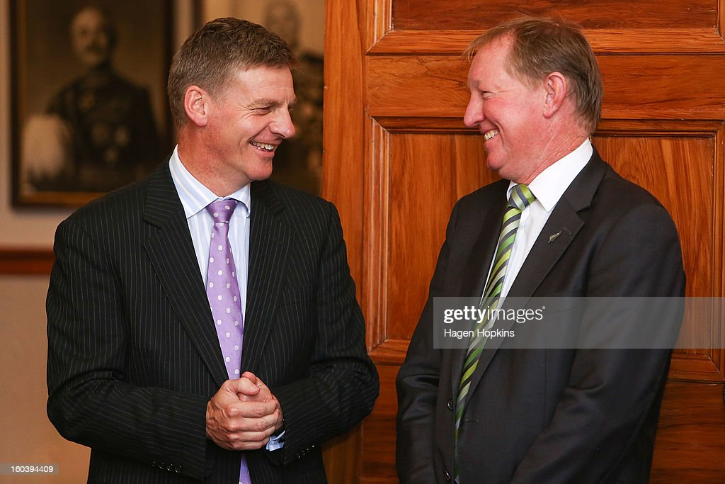 Deputy Prime Minister Bill English (L) shares a laugh with Nick Smith during a ceremony at Government House on January 31, 2013 in Wellington, New Zealand. After a recent Cabinet reshuffle by Prime Minister John Key, Dr Nick Smith was appointed Minister of Housing, Nikki Kaye was appointed Minister for Food Safety, Youth Affairs and Civil Defence while Michael Woodhouse was appointed as a Minister, outside of Cabinet, for Immigration and Veterans Affairs.