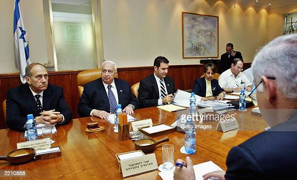 Deputy Prime Minister Ehud Olmert and Israeli Prime Minister Ariel Sharon attend the weekly cabinet meeting July 27 2003 in Jerusalem Israel US...