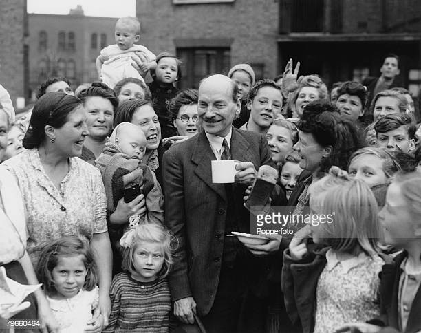 Deputy Prime Minister in the wartime coalition, Clement Attlee, pictured chatting to constituents in his Limehouse constituency where he is the...